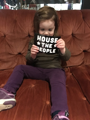 "A young advocate excited about the ""HOUSE THE PEOPLE"" postcard campaign"
