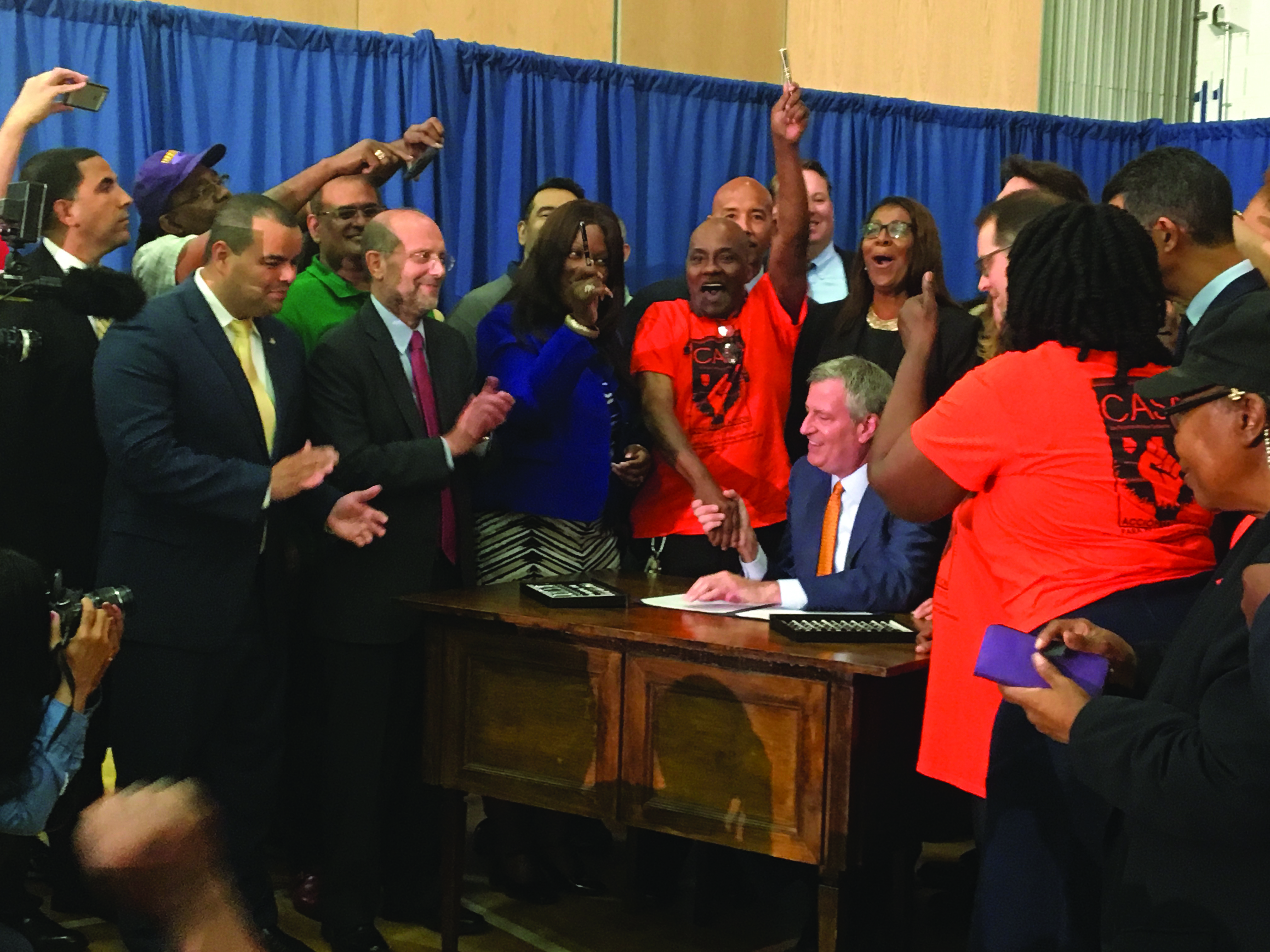Advocates celebrate Mayor Bill DeBlasio signing New York's new Right to Counsel law